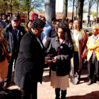 brontë velez hands Dr. Bernice King a gun to be delivered to the furnace on the 50th anniversary of her father's assassination.